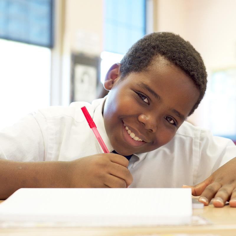 boy-smiling-writing
